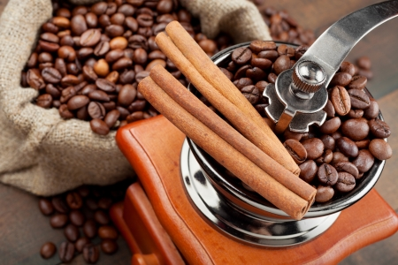 coffee grinder and sack with coffee beans photo