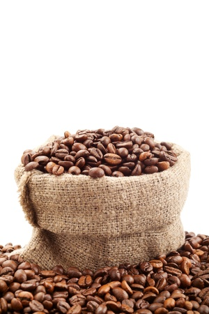 canvas sack with coffee beans on white photo