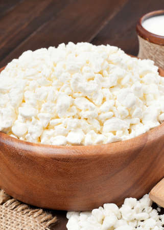 quark: cottage cheese in rustic wooden bowl Stock Photo