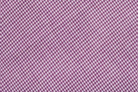 flores fucsia: patrón de tartán púrpura, tela a cuadros Foto de archivo