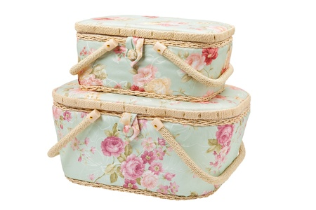 basket embroidery: two baskets for storage of accessories for sewing, silk case for needlework utensils, isolated Stock Photo