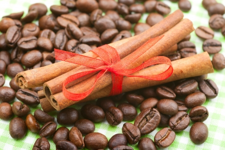 cinnamon sticks with red ribbon on coffee beans photo