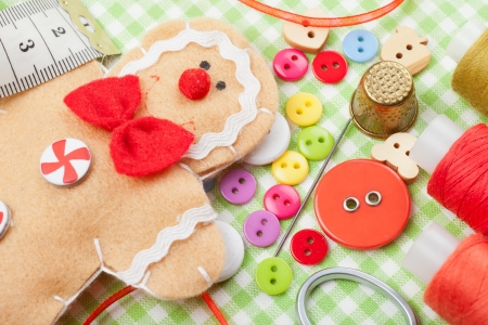 art and craft equipment: Sewing set and handmade gingerbread man from textile