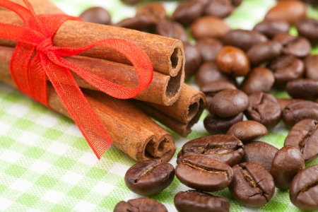 cinnamon sticks with red ribbon and coffee beans photo