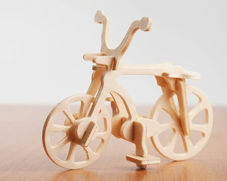 woodcraft: wooden bicycle toy - woodcraft construction Stock Photo