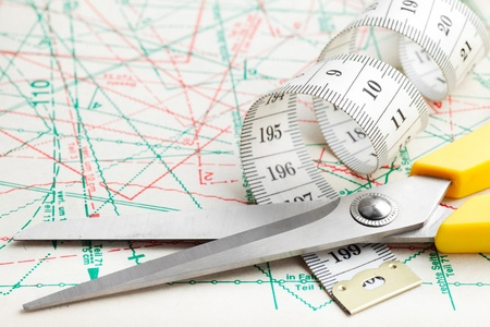 tailor measuring tape: scissors and measuring tape on sewing pattern Stock Photo
