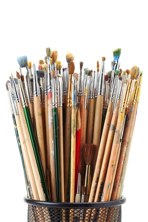 paintbrushes in black holder cup on white Stock Photo - 17857883
