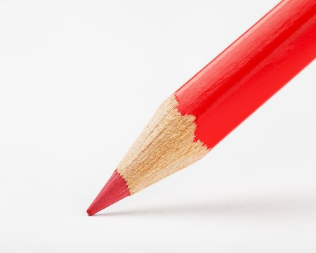 red pencil draws or writing on white paper sheet Stock Photo - 17857882