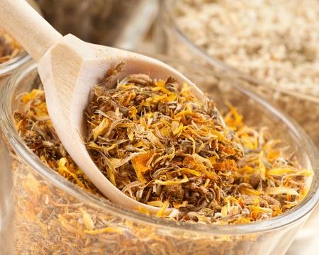 healing herbs in wooden spoon closeup Stock Photo - 18435247