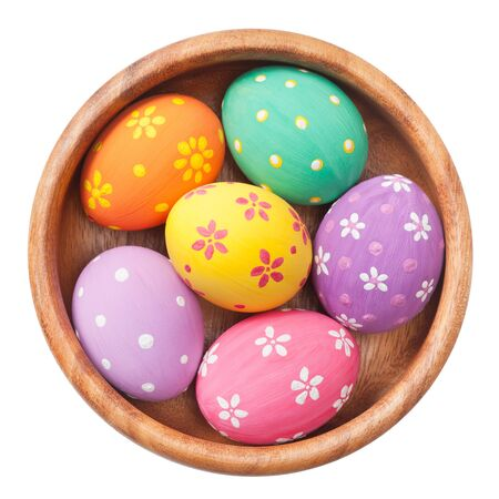 easter eggs in wooden bowl, isolated photo