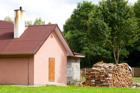 lodge: small detached house with firewood outside