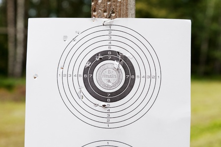 sniper training: Shooting practice target with bullet holes Stock Photo