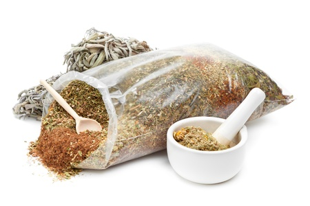 bag of healing herbs, mortar and pestle, herbal medicine photo