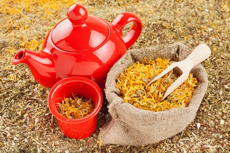 bag with healing herbs and red tea kettle, herbal medicine  Stock Photo - 19449974