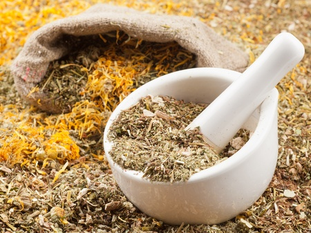 mortar, pestle and bag of healing herbs, herbal medicine photo