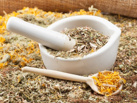 mortar, pestle and healing herbs, herbal medicine photo