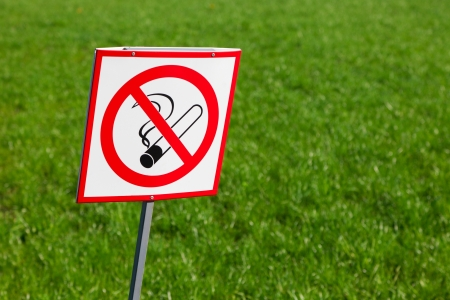 abstain: No smoking sign on green grass background Stock Photo