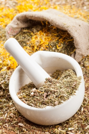 mortar, pestle and sack of healing herbs, herbal medicine  photo