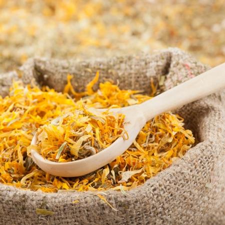 sack of healing herbs and wooden scoop, herbal medicine  Stock Photo - 20141160