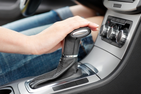 hand on automatic gear shift, woman in luxury car Stock Photo