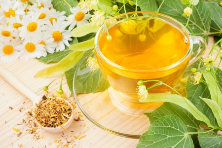 chamomile tea: linden and chamomile flowers and cup of healthy tea, herbal medicine Stock Photo