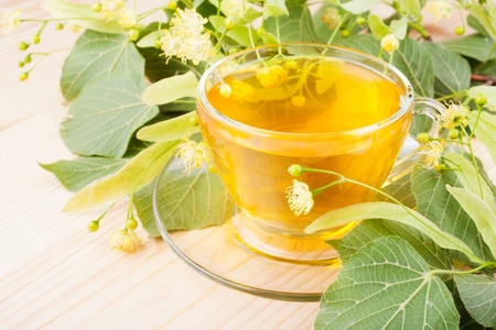 basswood: linden flowers and cup of healthy tea, herbal medicine