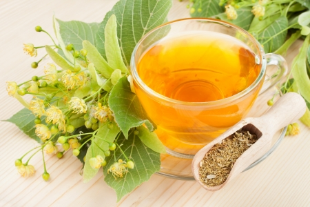 linden flowers and cup of healthy tea, herbal medicine Stock Photo - 20458780