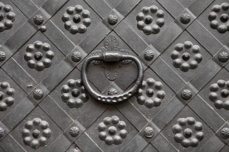 knocker: gate with door knocker, decorated with wrought iron