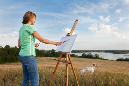 artist painting: artist painting an sea landscape Stock Photo