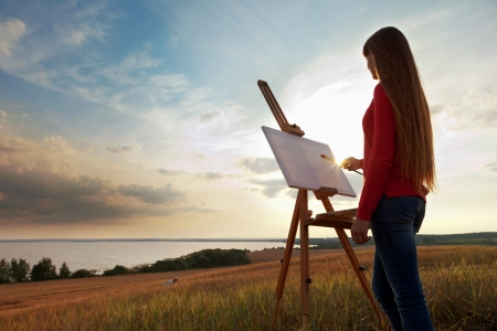 artist easel artist painting an sea landscape stock photo