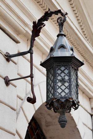 decorative decorative street lamp on building wall Stock Photo