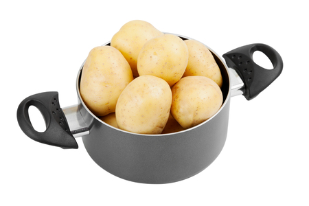 stew pot: fresh potatoes in cooking pot, isolated