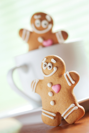 funny gingerbread men play about a cup photo