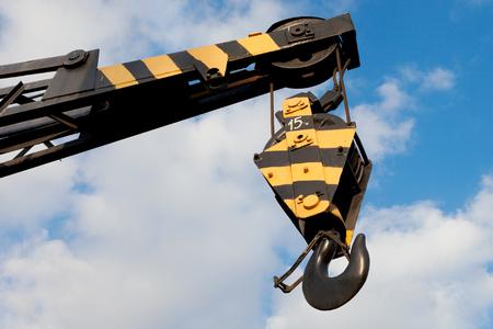 weight lifter: crane hook on a blue sky