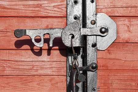 Closeup of a vintage wooden latch on a building photo