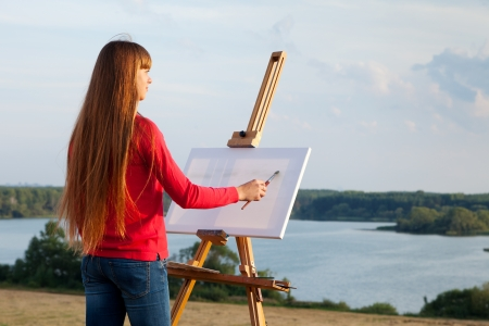 artist painting an sea landscape Stock Photo