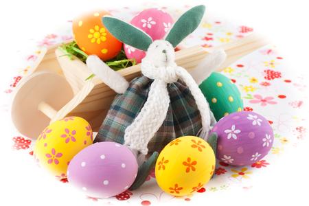 bunnie: Cute Easter bunny rabbit with a little wheelbarrow and eggs Stock Photo