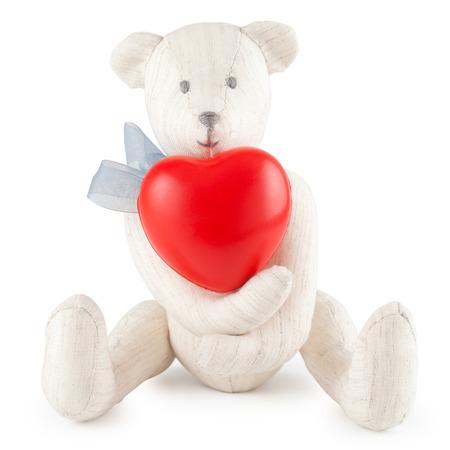 teddybear: Toy handmade teddy bear with red heart on white