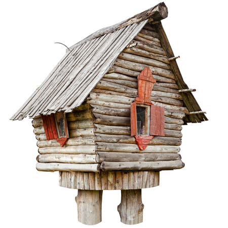village house: fairy witch house on chicken legs from folklore, isolated