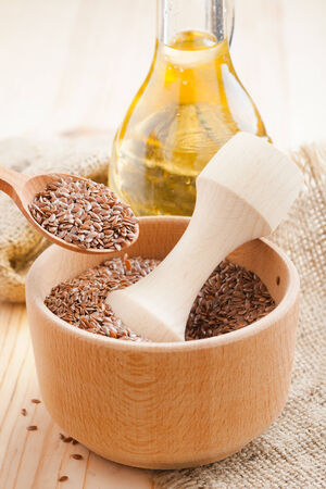 flax seed oil:  mortar with flax seeds  and linseed oil in glass jug