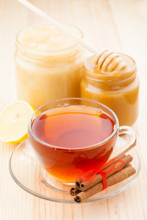 honey in jar and cup of healthy tea Stock Photo