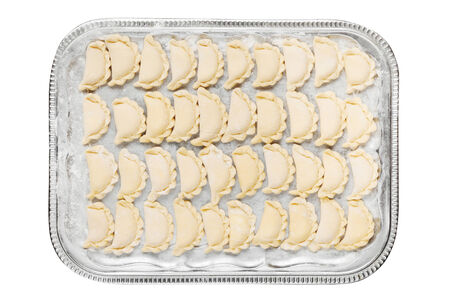 pierogi: dumplings on a tray, isolated