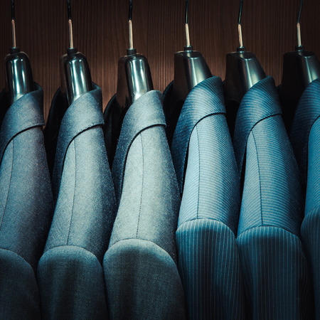gray suit: Row of men suit jackets