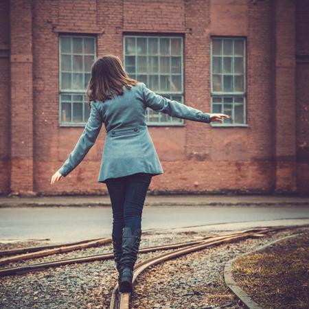 girl walking on the railway photo