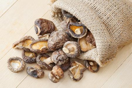 dried shiitake mushroom in hessian bag on kitchen table