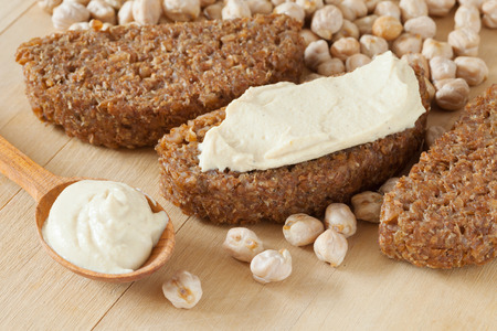 pate: bread slice with hummus dip and chickpeas grains