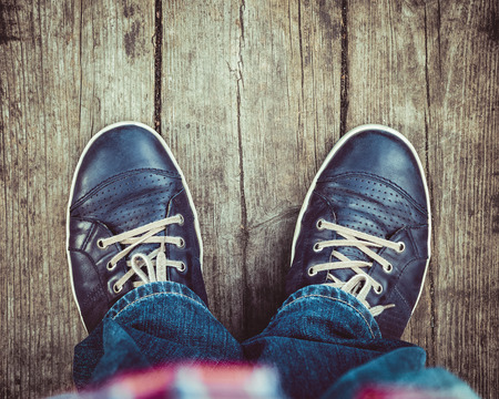 walking shoes: blue shoes on wooden planked floor from above