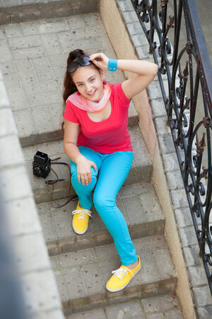 teenager girl sitting on the stairs photo
