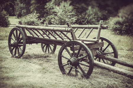 old wooden cart on field, vintage stylized photo photo