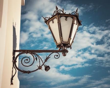 decorative  wall street lamp on blue sky background photo